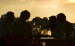 See how much a bit of eating and singing at sunset can make you feel rich...